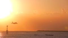 Landing plane on Jimbaran airport beach. Sunset at Jimbaran beach. Stock Footage