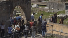 Group of travellers viewing remains of ancient historical place, tourist flow Stock Footage