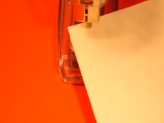 Stapling yellow post it papers with stapler Stock Footage