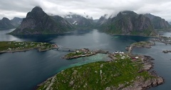 Lofoten mountains and islands around fishing villages Reine and Hamnoya Stock Footage
