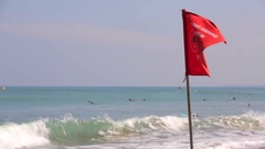Tourists on a beach. Waving red flag. Kuta Beach resort in Bali. Rip current. Stock Footage
