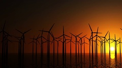 Seamless Looping Animatoin of Modern Wind Turbines in the Sea at Sunset Stock Footage