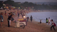 Chef cooking and selling roast corn in a Jimbaran beach. Tourists Stock Footage