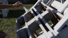 Process of Painting with a brush Wooden bench of pallets Stock Footage
