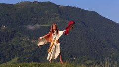 Shemale Sirena Sabiha dancing with a fan at sunrise in Pokhara, Nepal . Close up Stock Footage