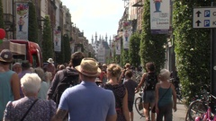 People walking in a main street Stock Footage