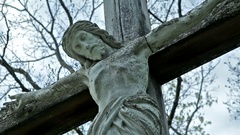 Christian Cemetery Jesus Statue on the Cross Crane Shot 01 HQ Stock Footage