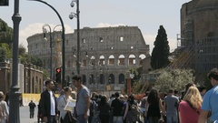 Slow motion of many people walking near Colosseum, tourist flow to summer Rome Stock Footage