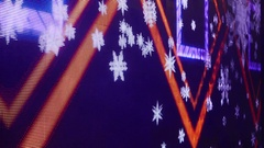 Colourful geometric figures and snowflakes on LED display, close up view Stock Footage