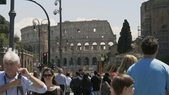 Crowded street near ancient Colosseum amphitheater in Rome, tourists in Italy Stock Footage