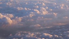 Aerial view on white fluffy Cumulus clouds. View from a plane. Stock Footage