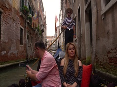 Beautiful lovers couple in Venice on Gondola ride. Romance shot in boat. Stock Footage