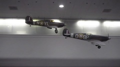 Model fighter jets on ceiling airplanes panning travelers interior SFO airport Stock Footage