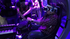 Teenager playing auto simulator game with PlayStation VR glasses Stock Footage