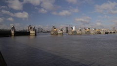 London Thames River flood barrier raising, time-lapse, extreme wide Stock Footage