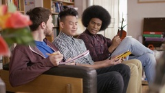 4K Male students studying together in shared accommodation Stock Footage