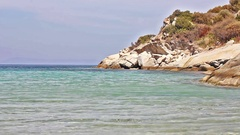 Seascape and rocks shore, beautiful turquoise sea on the summer day Stock Footage