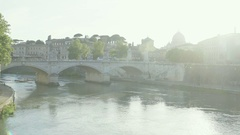 Ancient city lit by sunlight beams, bridge across river, cityscape panorama Stock Footage