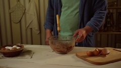 Man whisking baking ingredients into glass bowl at kitchen. Homemade cake Stock Footage