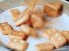 Falling hardtack biscuit on a plate Stock Footage