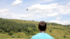 A man controls a drone at river Stock Footage