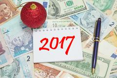 Notebook page with text 2017 background from different world Currencies Stock Photos