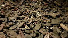 The remaining shoes of victims Of Holocaust In Auschwitz Concentration Camp Stock Footage