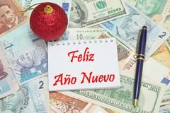 """Notebook page with SPANISH text """"FELIZ ANO NUEVO"""" (HAPPY NEW YEAR), background Stock Photos"""