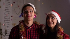 Happy teens in Christmas het looking on rain of a confetti, slow motion 1 Stock Footage