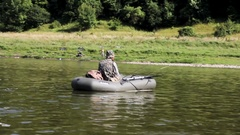 Fisherman in search of a place for catching fish Stock Footage