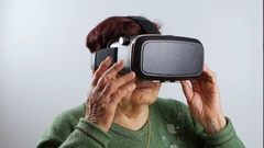 Close-up of grandmother using virtual reality headset, VR mask Stock Footage