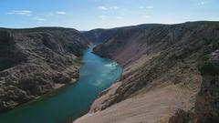 Aerial - Flying backwards and hiding beautiful river Zrmanja Stock Footage