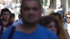 People walk in central Istanbuls avenue, the main shopping road Stock Footage