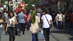 Large crowd of commuters and pedestrians walk on to the Square of Taksim Stock Footage
