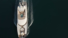 Aerial - Top down view of luxury yacht with a pool and helicopter passing by Stock Footage