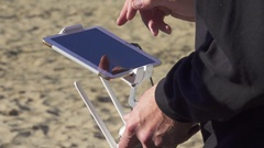 Man controls the drone by pressing his finger on the tablet screen Stock Footage