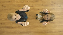 The kids thumb up to the camera. View from above. Real time capture Stock Footage