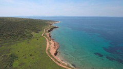 Aerial - Flying above the coast of terra rossa soil with a nice turquoise water Stock Footage