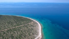 Aerial - Flying above the coastal road on island Vir in Croatia on a sunny day Stock Footage