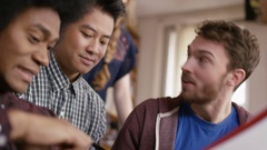 4K Close up cheerful student group studying together in shared accommodation Stock Footage