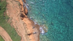 Aerial - Coast of terra rossa soil with a nice turquoise sea water Stock Footage