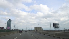 Driving into the city of Toronto on the Gardiner expressway highway Stock Footage