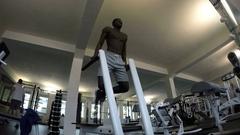 Black man trains shirtless in Gym Stock Footage