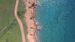 Aerial - Vertical view of calm waves hitting the shore Stock Footage