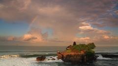 Sunset over hindu temple Pura Tanah Lot, Bali, Indonesia Stock Footage