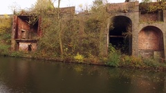 Tracking shot on an industrial stretch of old canal. Stock Footage