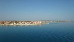 Aerial - Flying toward seaside houses on island Vir in Croatia Stock Footage