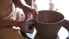 Potter making clay pot with hands Stock Footage