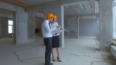 Architect and investor, businesspeople checking new building inder construction Stock Footage
