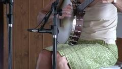 Woman playing banjo Stock Footage